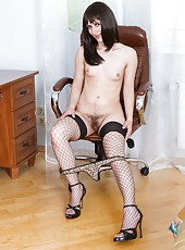 Sleek hairy girl Mary strips. With her top gone, she rolls down her panties, showing the pubic hair that pokes out from behind them. She strips naked, reclining on the chair and opening her legs.