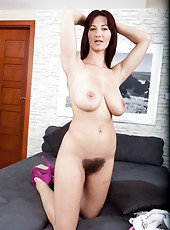 Wearing a low cut white top, hairy Vanessa J slowly strips and shows off her beautiful tits. Then she finishes the show while playing with her hairy pussy with her blue toy while keeping her heels on.