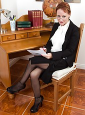 In the office, Tiffany T strips off her professional outfit to reveal her sexy see-through panties and lacy stockings. She gets on her desk and spreads her hairy pussy nice and wide.