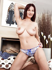 Lounging around the living room in her pretty blue dress, Vanessa J plays with her big tits and then strips off her clothes. She just can
