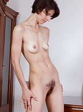 Always a class act, Milady is home from the ball in her striking gown and ready to touch that hairy body all over. She plays with her perky tits before giving that hairy pussy some much needed love.