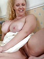 Teya has just came out of her shower and starts to run her hands up her furry legs. This hot hairy woman can