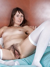 In her white bustier and purple panties, hairy girl Charlotte B doesn