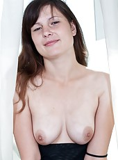 Gerda is a petite brunette with a love of wearing sexy lingerie that show off her natural breasts and her hairy pussy.  She enjoys playing with her pussy while wearing sexy ligerie for all her fans.