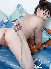 Candy S looks cute with her hair in pigtails with the different colored hair ties. She stakes off her clothes and grabs her toy and plays with her hairy pussy with her legs spread in bed.