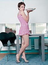 Bringing in the pizza in her red striped dress, Karina is about to deliver more than a pie! Setting the pizza down she sits on the table and shows her hairy pussy as she strips off all her clothes!