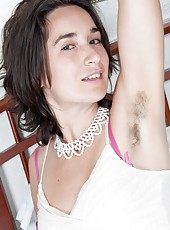 Penelope is a great looking brunette and a beautiful petite woman, who enjoys laying naked in bed.  She lays down on her bed and begins to undress so she can play with her hairy pussy.