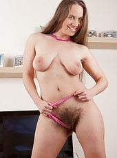 Erin Eden takes off her outfit and plays with her hairy pussy. Stretching her pussy lips with her legs spread she gets her pussy nice and wet! Pleased with herself she spreads her ass cheeks next.