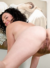 Sofia Matthews is a little restless standing in the living room. She likes the feel of tugging on her hairy pussy as she slowly takes off her clothes. She is compelled to spread her legs and play!