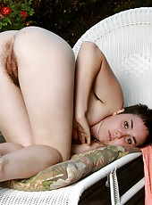 Sexy Barb plants a hand on either ass cheek and spreads her hairy bush for you all to admire. She smiles cheekily at the thought of being caught outside in the raw!