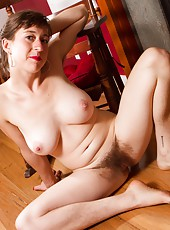 Charlie unveils her sexy natural body and finger fucks her pink hairy pussy in front of the fire place.