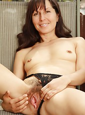 While basking in the warm sunlight, kinky mature Carmen uses her fingers to spread her warm moist hairy pussy lips!