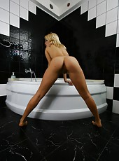 Allison washes off her thick pussy hair in the bath and vigorously lathers up her sexy natural body.