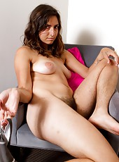 Reclining on a chair, Monica strips her extremely hairy body out of her clothes and quickly jams her glass dildo deep in to her bush. Thrusting just enough to make her toes curl.
