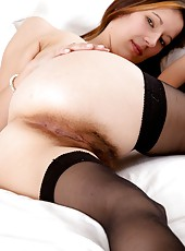 Unbelievable. Sadie Matthews could make anyone hard with her beautiful body and perfect hairy pussy. A true natural treasure in sexy black lingerie.