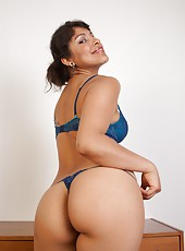 See sexy Latina Laurie pull herself out of her tight little dress and shows off her sexy new blue lingerie. Hey curvy ass and dark skin truly complement her dark thick hairy pussy.