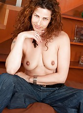 Sexy experienced Yvette cant wait to be inside herself. After her seductive slow striptease, she cameltoes her bush and then slides a finger in.
