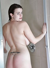 Fleshy big titted hair lover Destiny S is feeling dirty and needs a good scrub. She jumps in the shower to cool off but ends up playing with her  thivk dark hairy pussy instead.