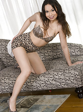 Asian minx Sasha Yung lifts her leopard print mini skirt reveling her thick, dark and moist hairy pussy. Watch her lounge back on the couch, arch her back and spread her pink bush