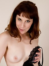 Hot milf Helena gets straight to the point and after fingering her warm thick bush, she re-inserts her favorite purple dildo until she cums.