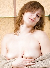Hairy milf Kate L is warmed up by her cup of tea, so much that she strips out of her sexy denim jeans and sneaks a finger into her hairy pussy.