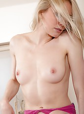 Sexy blonde Cate should be getting ready for work, but instead she thinks its time for some sexy play with her lovely firm body and thick ginger pussy hair.