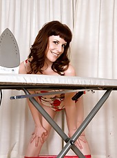 Helena the hairy milf is doing a spot of ironing, but succumbs to her urges to pull out her big moist bush and stuff her panties inside it.