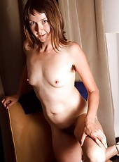 Watch in amazement as sexy Charlotte B strips and stuffs her bush with a cold vibrator. See her smile light up as is hits sensitive spots deep within her hairy pussy.