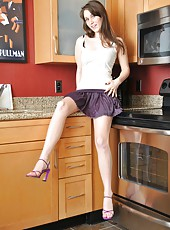 Michelle L bares her moist hairy box in the kitchen and almost sticks to the bench top. This perky girl lifts her skirt to show her perfectly packed bush.