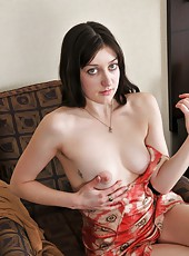 Off with her sexy red dress, and out with her dark haired pussy. Get aroused as Wendy slowly strips on her comfy brown chair.