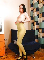 Take a front row seat and watch Klarissa spread and play with her moist, warm, and hairy pussy through her long green stockings. She will certainly put a smile on your face.