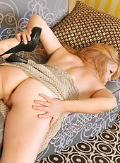 Curvaceous Autumn smiles sexually as she pulls her black panties to the the side, showing off her natural ginger pussy hair. Watch her push her dildo deep inside.