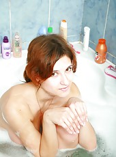 Penelopa soothingly massages her big breasts and feels her beautifully hairy pussy moisten as she soaks in the bath.