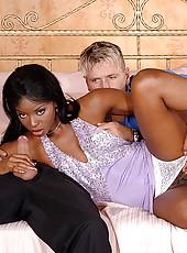 Sexy ebony taking two hard cocks