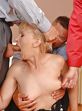 Blonde MILF Slobbers On Three Dicks
