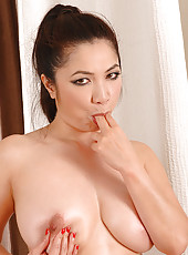 Exotic Asian Masseuse Sucking Cock