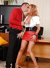 Busty secretary sucking a hard dick