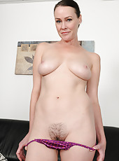 40 year old Veronica Snow stops doing her wash to show her furry muff