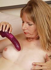 41 year old Lexa Mayfair presses her purple dildo deep inside her box