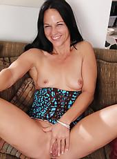 43 year old brunette MILF Kiera Blu spreading wide open on the sofa