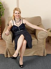 Elegant 50 year old Jennyfer B slides out of her dark evening dress