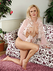 Cute blonde and 38 year old Elaine from AllOver30 strips off lingerie