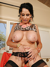 63 year old brunette Rita Daniels spread and playing with her boobs