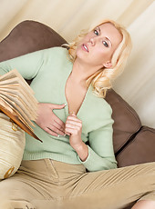 Horny blonde housewife enjoys a glass dildo while her hubby is away
