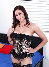 Raven LeChance loosens up her leopard corset for a view of her massive tits
