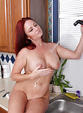 Housewife cools her warm moist pussy after working around the house