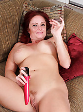 Horny mommy crams a dildo into her throbbing twat