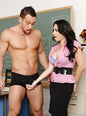 Busty brunette Holly West is a hot teacher who fucks a student on her desk.