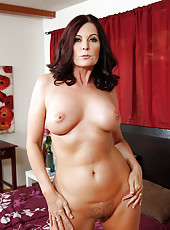 Hot brunette MILF fucks younger cock and has orgasms.