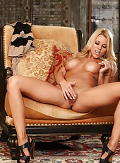 The beautiful Nicole Graves gets naked and shows off her tight pussy as she inserts her glass toy.